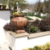 Stucco-Concrete-Retaining-Wall-with-Decorative-Concrete-Cap.jpg